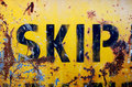 Rusty yellow skip the side of a industrial or dumpster with peeling paint Royalty Free Stock Photos