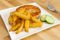 Rutabaga Fries and Salmon Burger Royalty Free Stock Photo