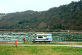Rv on the riverside of rhine with hills background Royalty Free Stock Photo