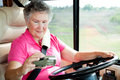 RV Senior - Woman Using GPS Stock Images