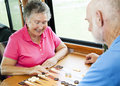 RV Seniors Play Board Game Stock Image