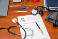 Rx prescription with pills, stethoscope, thermometer Royalty Free Stock Photo