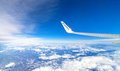 Ryanair airplane's wing and aerial view of Italy Royalty Free Stock Photo