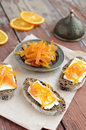 Rye bread with butter and homemade orange confiture on rusted wo breakfast wooden table Royalty Free Stock Photos