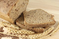 Rye bread with flax seeds still life and wheat ears Stock Photos