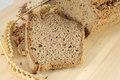 Rye bread with flax seeds still life and wheat ears Royalty Free Stock Image