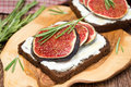 Rye bread with goat cheese fresh figs honey and rosemary close up Stock Photos