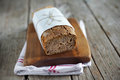 Rye bread loaf with oats wheat and flax seeds sliced rustic artisan style on tea towel Stock Images