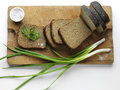 Rye bread sliced with green onion and salt Royalty Free Stock Photography