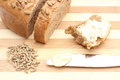 Rye grain, butter on knife and slice of bread Royalty Free Stock Photo