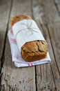 Rye rogenbrod pund loaf bread with seeds and whole grains rustic danish on tea towel Stock Photography