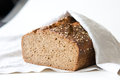 Rye sourdough bread covered with linen cloth shallow dof Stock Photos