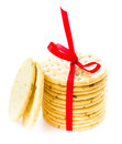 Słodcy ciastka wiążący z czerwonym faborkiem solated na białym tle Obrazy Royalty Free