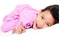 It s bedtime happy girl lying on the bed ready for Royalty Free Stock Images
