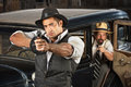 S era gangsters with guns and car vintage outside of antique automobile Stock Image