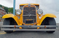 S ford model a hotrod front low angle shot of yellow Royalty Free Stock Image