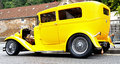 S ford model a hotrod side low angle shot of yellow Stock Photos