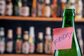 It s friday green beer bottle in a bar with a note Stock Photos
