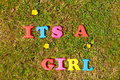 It s a girl alphabet letters on grass background spelling the words Royalty Free Stock Photos