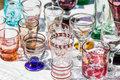 50s glasses in different colors and shapes at garage sal Royalty Free Stock Photo
