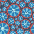 1970s Hippie flowers. Flower power seamless vector background. Blue and red abstract distressed flowers on a blue background.