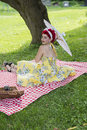 S lady with umbrella picture of a lovely retro an outdoors picnic Stock Photography