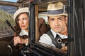 S lookout gangsters gangster couple on in their antique automobile Stock Image