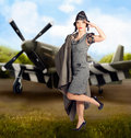 S military pin up girl air force style artistic photo illustration of a beautiful asian pinup woman in dress making a salute in Royalty Free Stock Photography