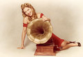 60s pin up girl with vintage record phonograph Royalty Free Stock Photo