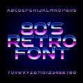 80's retro alphabet font. Metallic effect shiny letters and numbers. Royalty Free Stock Photo