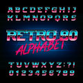 80`s retro alphabet font. Metallic effect shiny oblique letters and numbers.