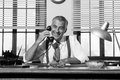 1950s smiling businessman on the phone Royalty Free Stock Photo