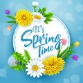 It`s spring time banner with round frame and flowers on blue sky background