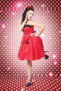 S style woman dancing at nightclub disco sexy with pinup haircut and retro polka dot dress on a dance floor Royalty Free Stock Photo