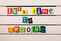 It's time to choose - written with color magazine letter clippings on wooden board. Concept  image Royalty Free Stock Photo