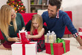 It s time to open gifts happy family opening christmas presents Stock Photography