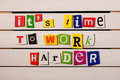 It's time to work harder motivational quote written with color magazine letter clippings on wooden board. Concept image