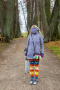 It s too cold to walk this autumn colorful girl on a day in the park Stock Photography