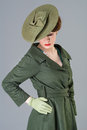 S vogue style beauty model in vintage green hat and coat Royalty Free Stock Photos