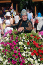 Sabantui celebration in Moscow. Senior woman surrounded by flowers