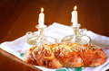 Sabbath image challah bread and candelas on wooden table Stock Photo