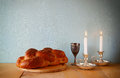 Sabbath image challah bread and candelas on wooden table Stock Images