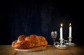 Sabbath image challah bread and candelas on wooden table Royalty Free Stock Image