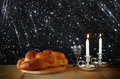 Sabbath image challah bread and candelas on wooden table glitter overlay Stock Photo