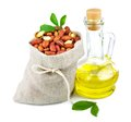 Sack of peanut and glass bottle of oil with leaves Royalty Free Stock Photo