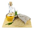 Sack of sesame seeds and glass bottle of oil Royalty Free Stock Photos