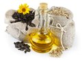 Sacks of sunflower seeds and glass bottle of oil Royalty Free Stock Photo