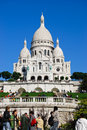 Sacre coeur cathedral paris france october tourists climb the steps up towards the known as basilique du sacré cœur as it sits Stock Photos