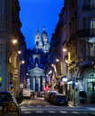 The sacre coeur viewed from the rue laffitte paris france april night view of cathedral in street on april in paris france Royalty Free Stock Photography