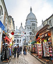 Sacre couer montmartre paris france december basilica of coeur on december in the center it is located the bibliotheque publique d Royalty Free Stock Photos